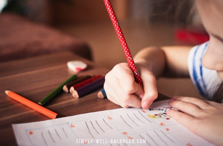 image of child sharing a pencil at school