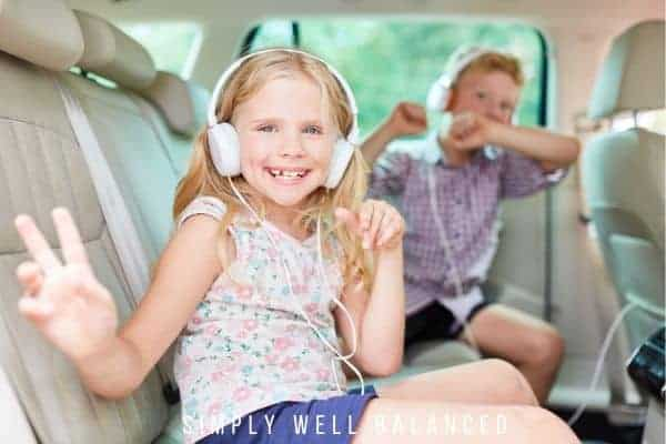 Car organization hacks: Two kids in the back of a clean and organized car
