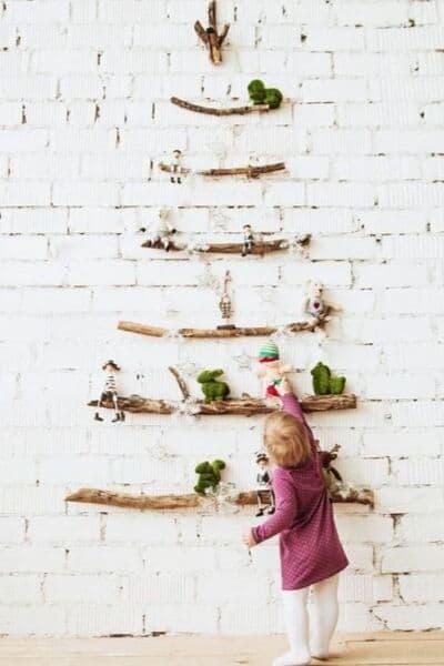 Toddler touching minimalist Christmas decorations