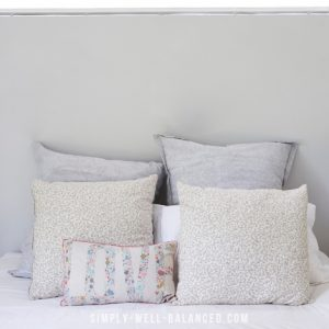 pillows on a bed in a clutter free bedroom