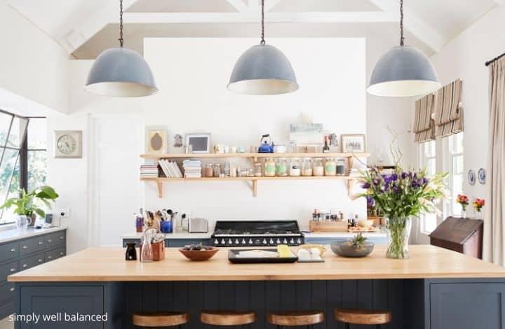 Modern, decluttered kitchen with island.