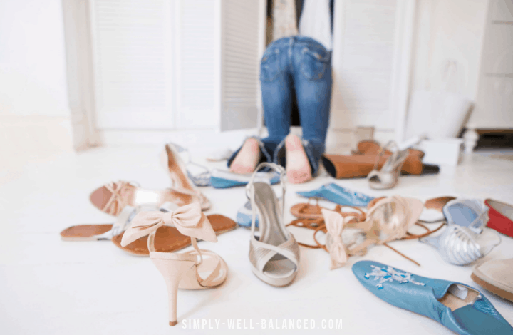 Woman declutter shoes in her closet.
