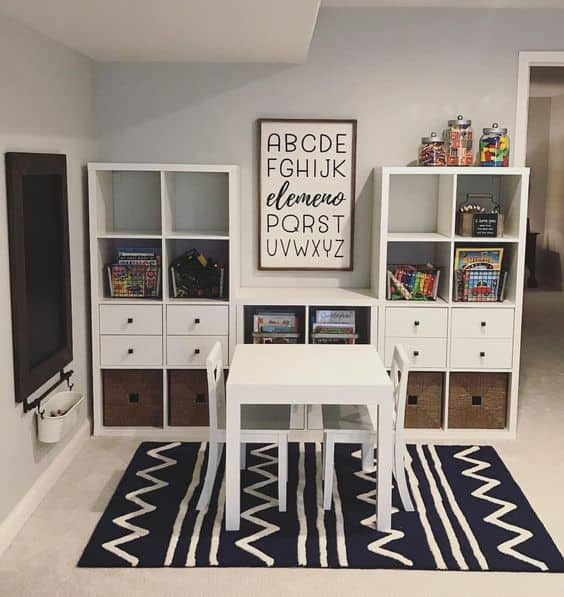 Minimalist playroom with bookshelves