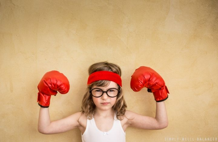 Confident little girl with boxing gloves on