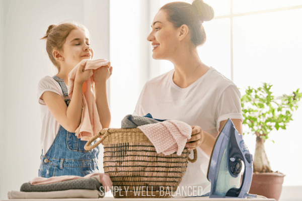 Girl smelling laundry