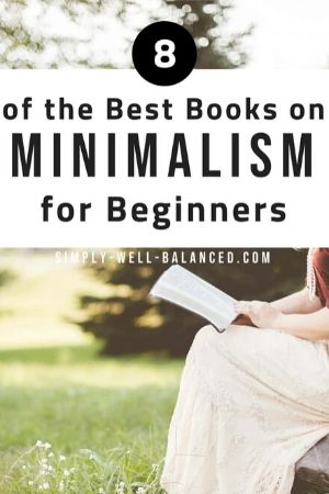 girl sitting in a field reading one of the best books on minimalism