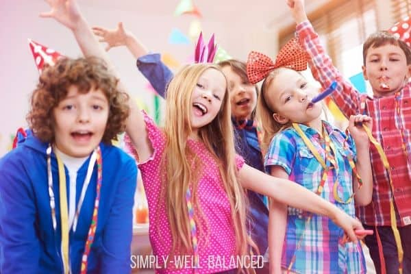 A group of children having fun at a birthday party.
