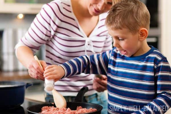 A family cooking a frugal ground beef dinner recipe.