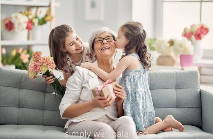 Granddaughters giving a Mother's Day gift to grandma