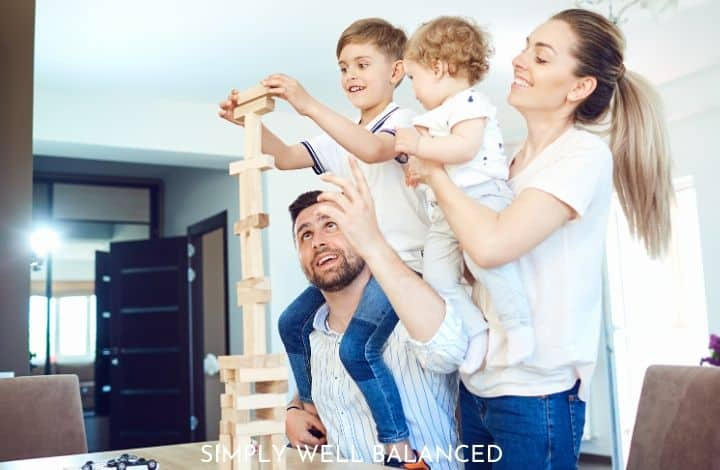 Minimalism with kids: family experiences over things. Family building blocks together.
