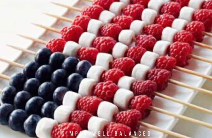 Patriotic Fruit Skewer snack for kids: marshmallows, blueberries and raspberries.