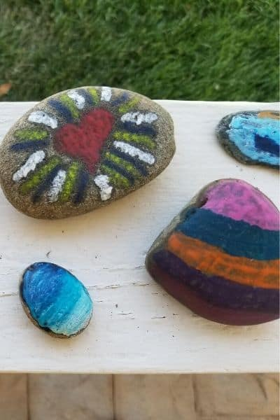 Rocks that have been painted with melted crayon.