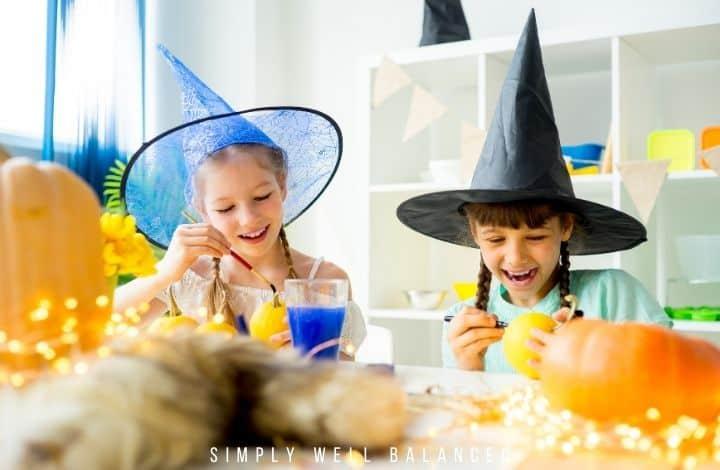 girls painting pumpkins for Halloween