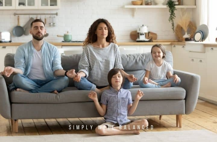 Family meditating on couch; create a peaceful home