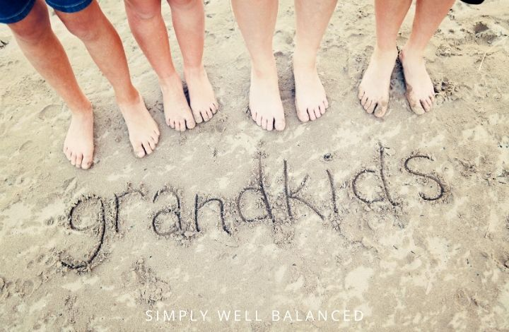 "Children's feet on the beach with the word ""grandkids"""