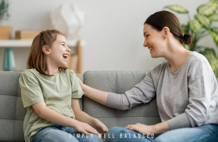 Mom and daughter talking and laughing