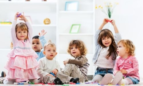 A group of preschoolers playing Simon Says