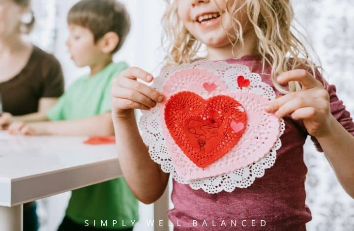 A family making Valentine's Day crafts together. Family Valentine's Day ideas