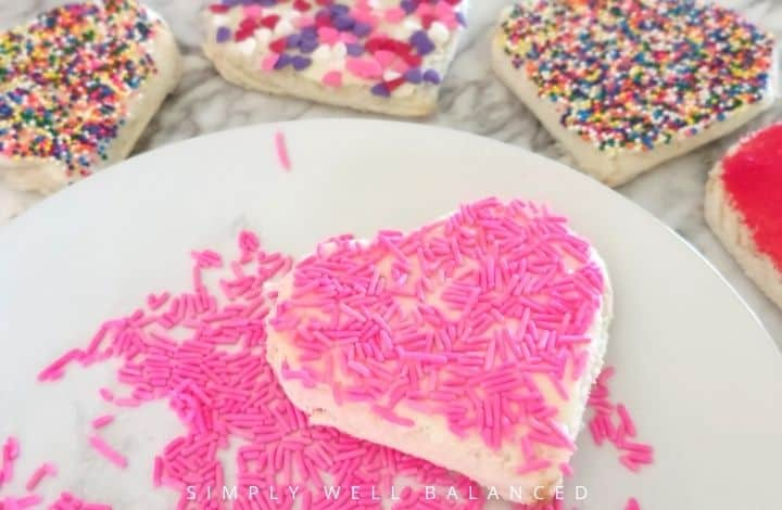 Pink jimmies on heart shaped fairy bread.