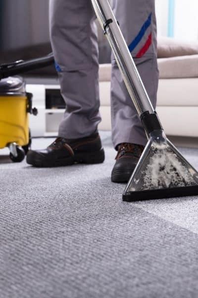 Professional carpet cleaner on Berber carpet
