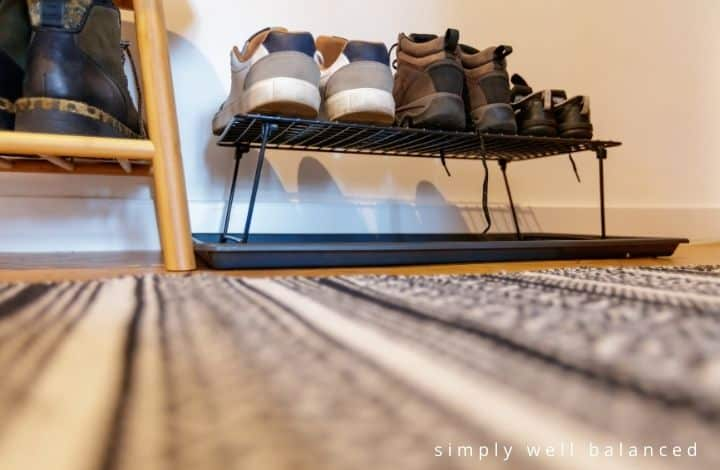Organize Kids Shoes | Kids shoes on rack in mudroom.