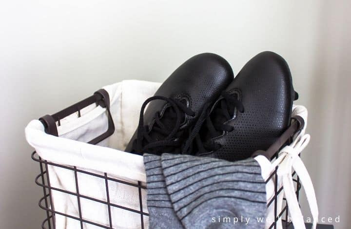 Kids shoe storage ideas: Wire basket with cleats and socks