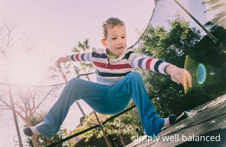 Child jumping on trampoline to calm down.