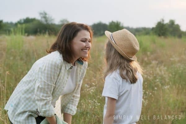A mother talking to a child using adjectives about kids to improve self confidence and self esteem.