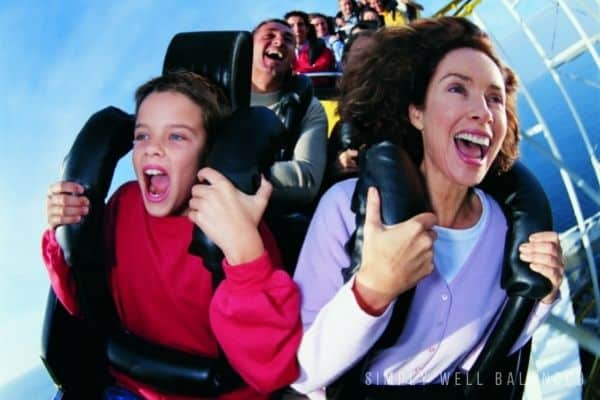 Mother and son riding a roller coaster